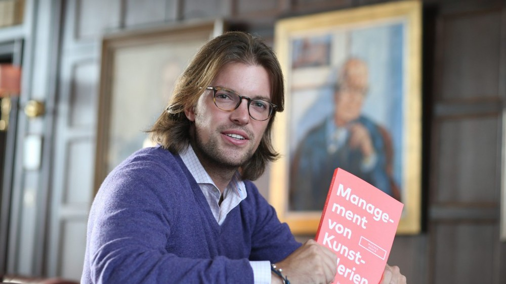 Magnus Resch with the German edition of his book  Management of Art Galleries . Image credit:  Observer .