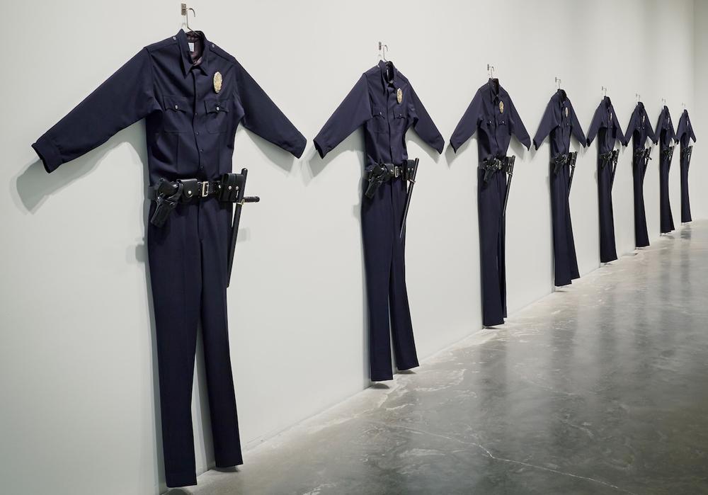 "Chris Burden, ""L.A.P.D. Uniforms"" (1993). Installation view. Image credit: Blake Gopnik"
