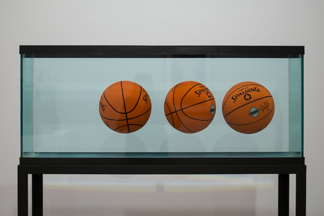"Jeff Koons, ""Three Ball Total Equilibrium Tank (Dr. J Silver Series),"" 1985. Image credit: Michael Groth for Hyperallergic."