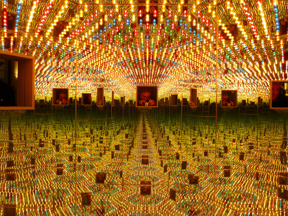 Yayoi Kusama's  Infinity Mirrored Room  (1994). Courtesy of Flickr user  Sjoerd Los .
