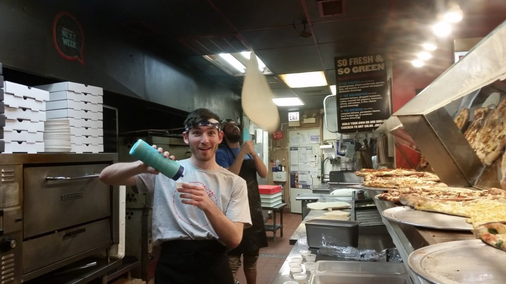 "My supervisor Shannon: ""Brandon, you fill those cups while Nick tosses a pizza and Ill take a picture!"" Me: ""Because these are equally cool tasks...."