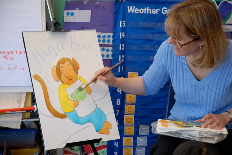 Emilie Painting a Monkey