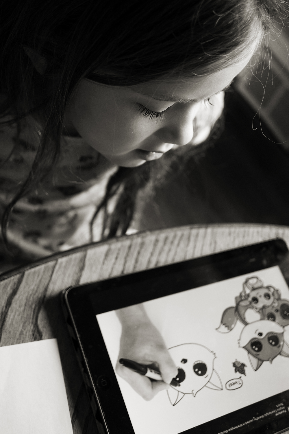 Columbus photographer takes pictures of daughter copying a fox drawing on her ipad in their worthington, ohio home.