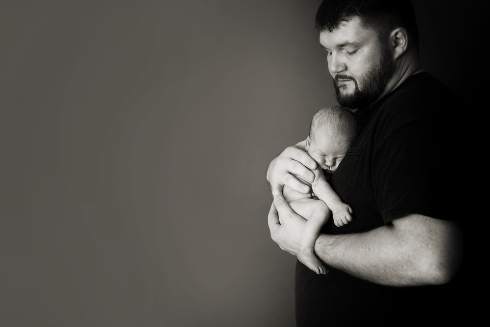 Columbus Ohio professional portrait photographer.  Newborn baby photography.  Father with infant son.