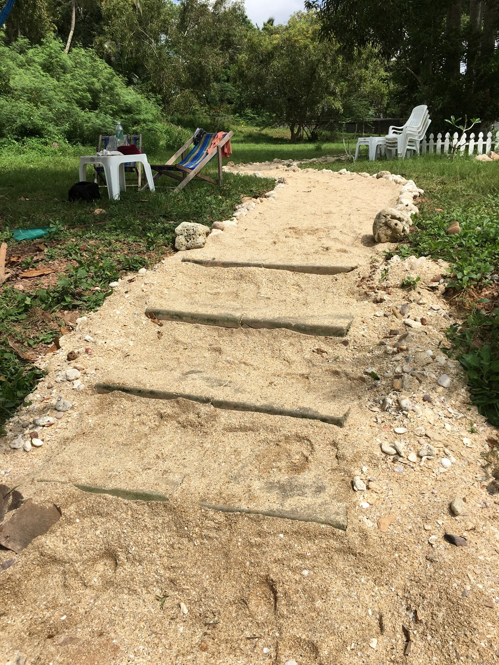We built new and improved steps down to the beach, too.  (In this picture, we aren't quite done, but close enough to give you the idea.)