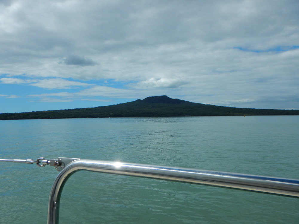 Passing by volcanic Rangitoto Island.  We considered anchoring here for the night, but decided to continue heading north to stay ahead of the weather approaching from the south.