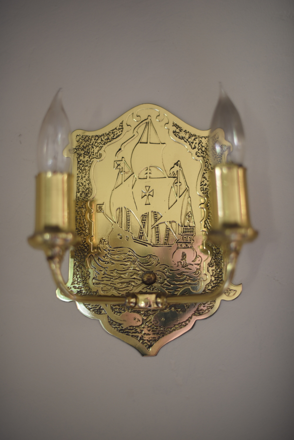 Another feature related to sailing:  Spanish galleons engraved on the lights in our living room.  Each of the four fixtures had a different engraving of a ship.  So cool, I never really noticed. (Or maybe I did notice but it just didn't hit home as much as it does now.)