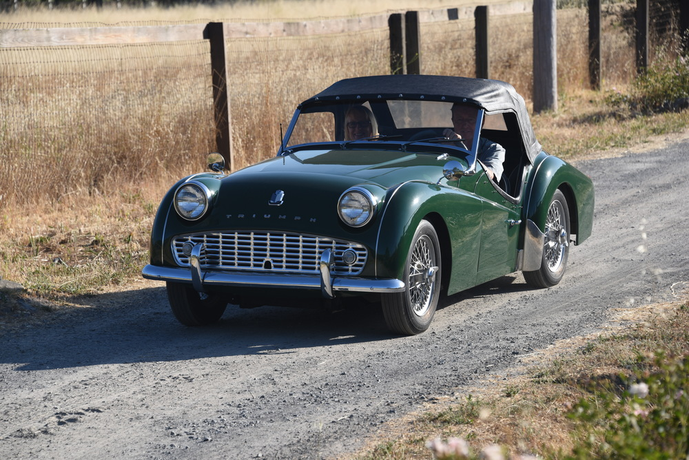 The Triumph TR3 arrives via delivery truck.  Owners driving up the driveway for the first time!