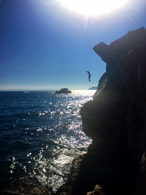 Cliff diving is a popular activity along the coast.