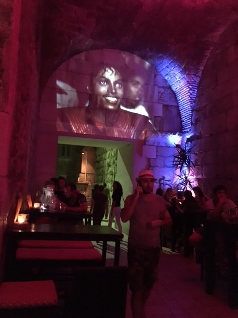 Music videos projected on the wall of Diocletian's Palace.