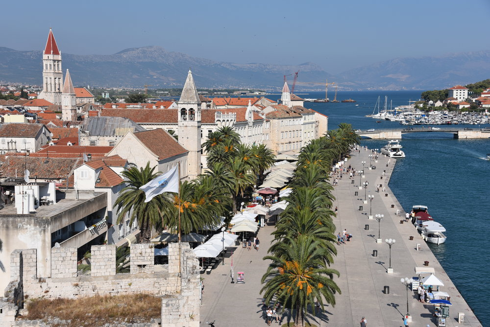 View from the fortress (see lower left for corner of fortress wall) at the end of the promenade in Trogir.  I watched a few super-yachts dock alongside here for the evening out.
