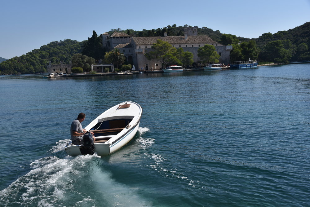 Here is the monastery and church on an island in the lake in the National Park Mljet, on the island of Mljet.  Confused?  Yes, it's an island on a lake on an island.  We took this little boat as transport to visit the small island.  (Sign said swimming there wasn't allowed.)
