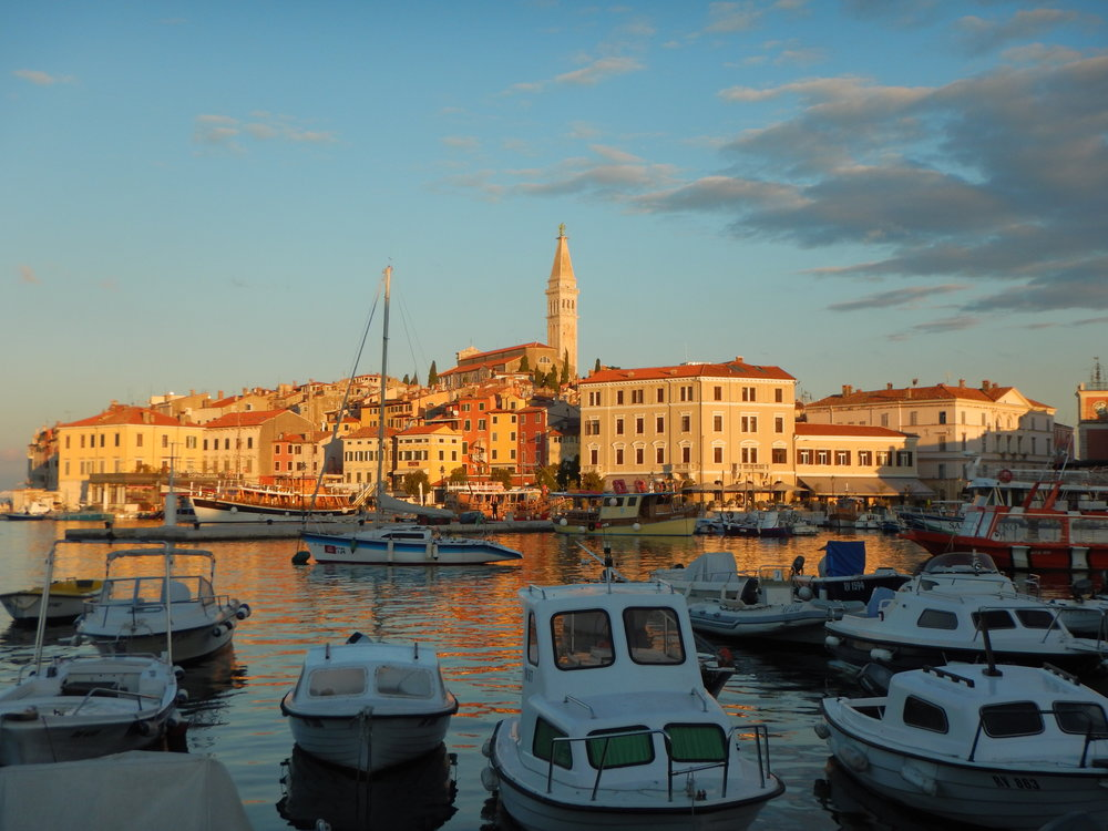Rovinj at sunrise, with the Church of St. Euphemia towering above all.