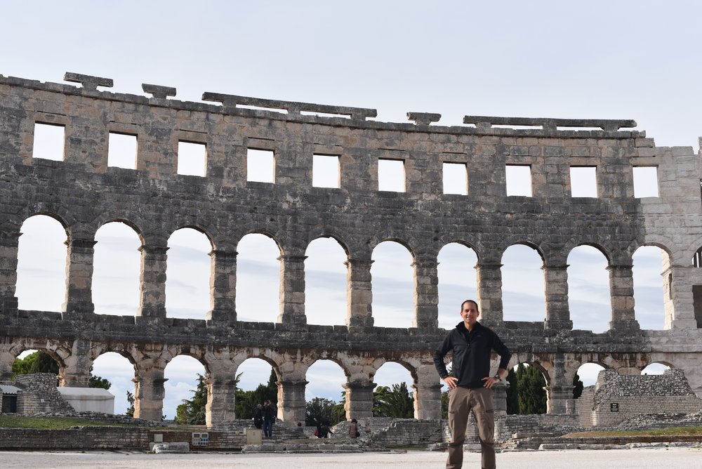 Standing in the middle of the Pula Arena.