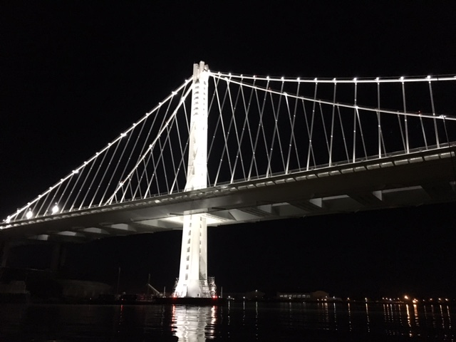 Enjoying a night sail... under a bridge, under a full moon, under a shooting star, and unfortunately, under the weather.