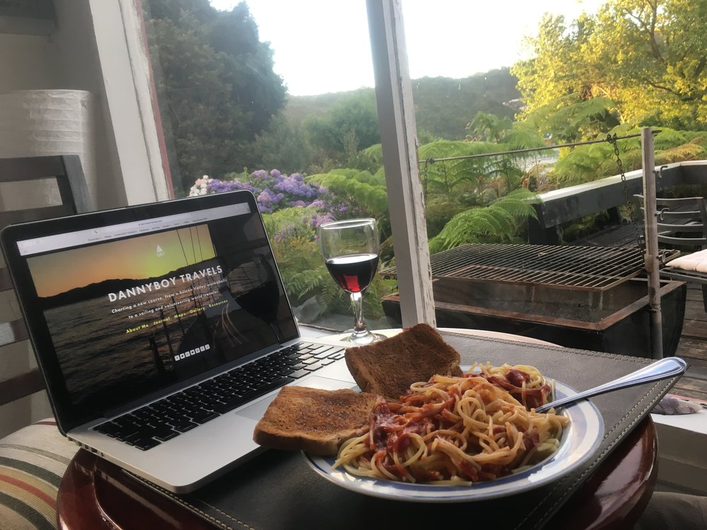 A typical evening after work.  Pasta, wine, internet, and a fantastic view of the garden and bay.