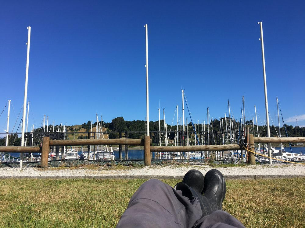 Relaxing at Club Nautico Reloncavi (on the mainland), waiting for guests to arrive.  This part of the job isn't very tough.