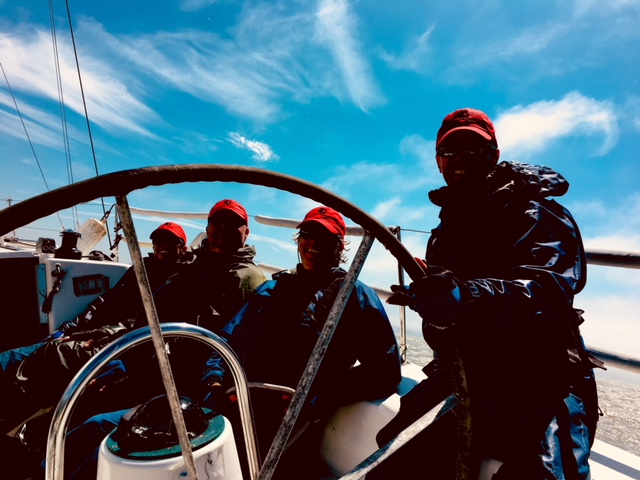 Darkened the photo to protect the innocent, but trust me, the group was all smiles during this team-building event on the SF Bay.