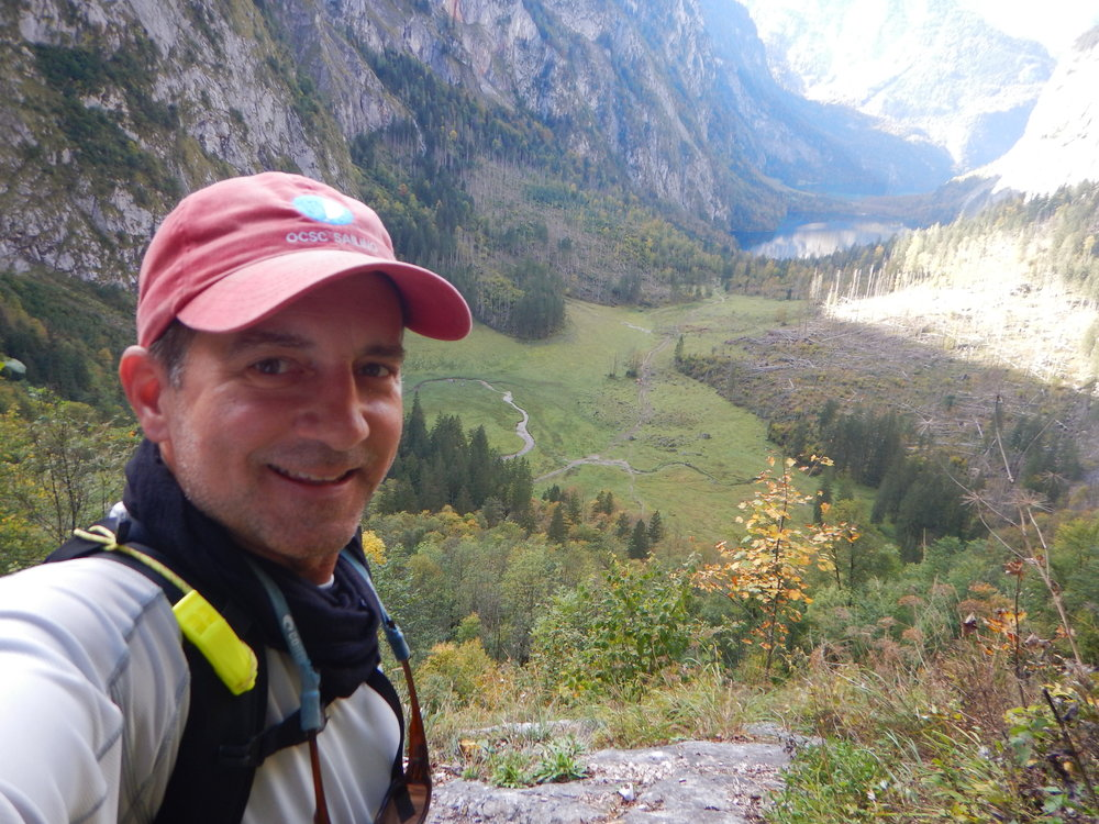 Steep descent back into the valley, looking at Obersee and Konigssee lakes in the distance.
