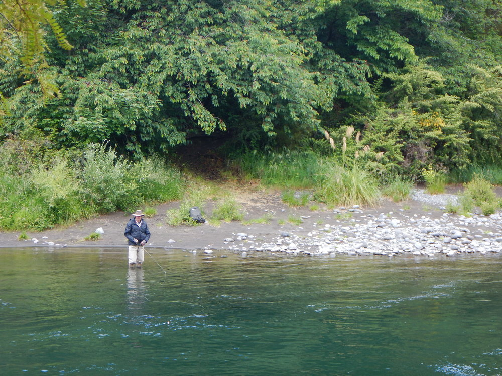 This fly fisherman caught a fish soon after I took this photo.  He was excited, and hollered over asking me if I'd caught the catch on film.