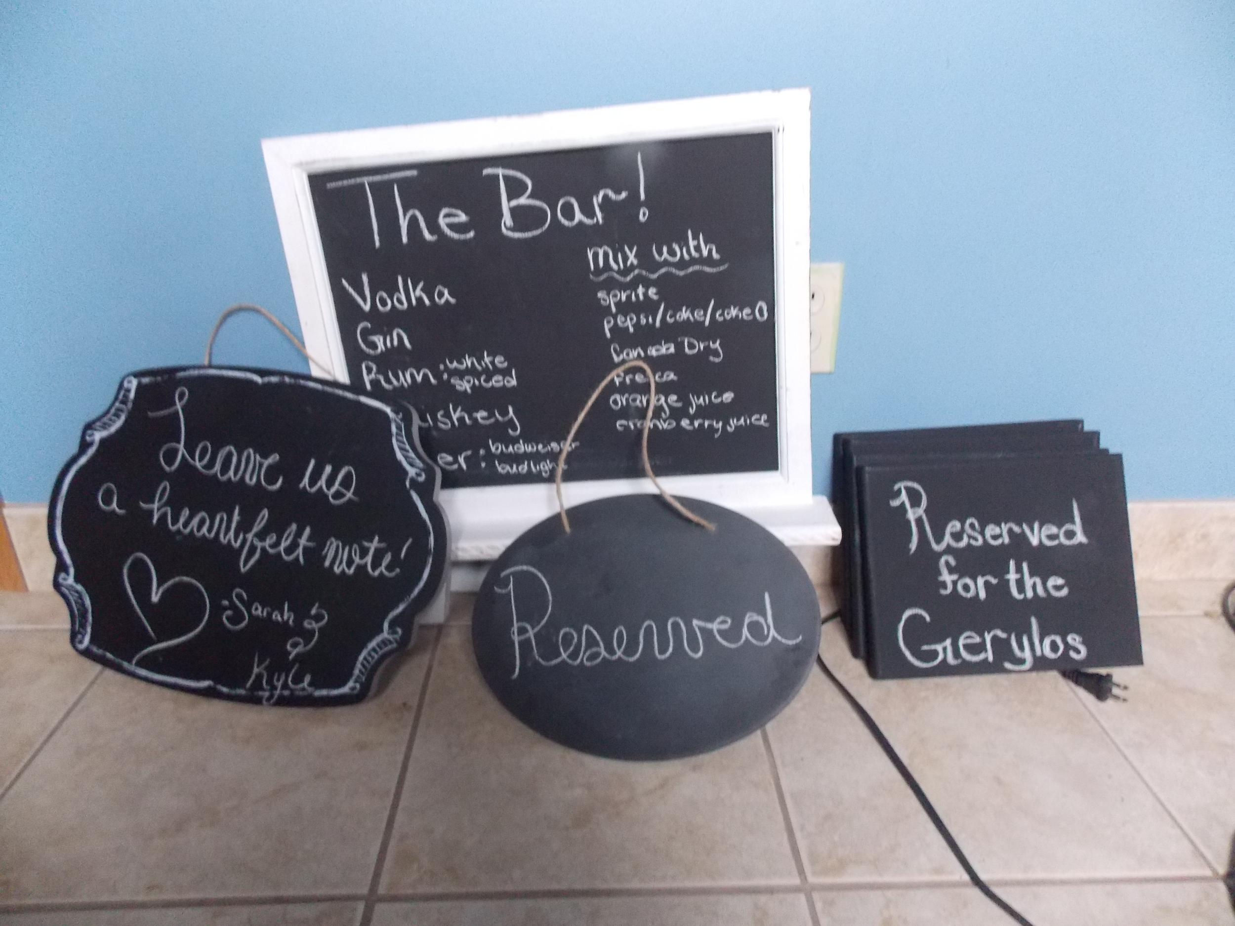 A few of our chalk board signs! The square ones to the right are just black canvases that were less expensive but work perfectly as little chalk boards!