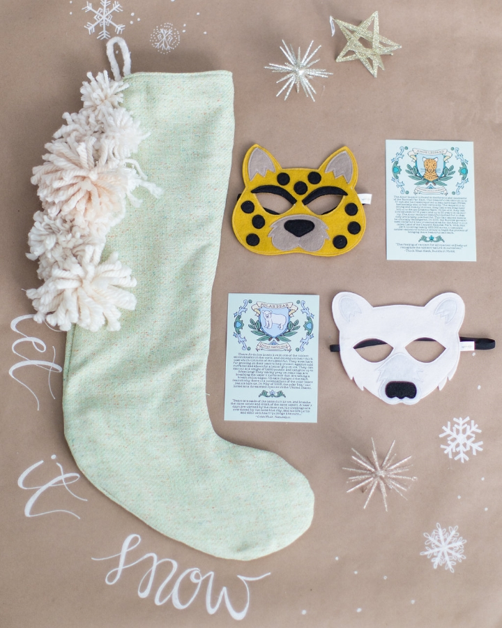 Stocking by Tinsel, calligraphy by Octavia Spiker, animal masks and cards by Opposite of Far