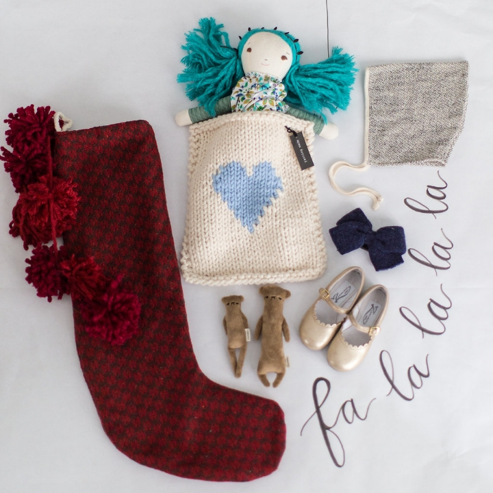 Styling by Mari Spiker, stocking by Tinsel, handmade bears by Commonfolk, handmade gold mary jane shoes by Zimmerman, soft bonnet by Petite Soul, doll found at The Land of Nod, doll blanket by Yarning Made, and wool bow by Wun Way.