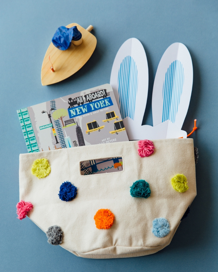 Pom Pom Canvas Bag, Paper Bunny Ears, and Book all from Anthropologie, Boat from Fawn Shoppe