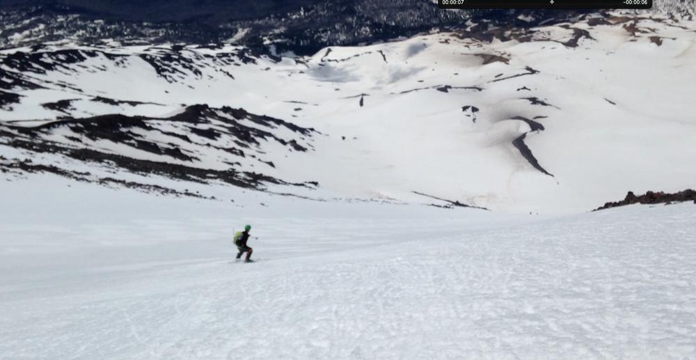 heading down the steep chute. the missing ski is a few thousand vertical feet down.
