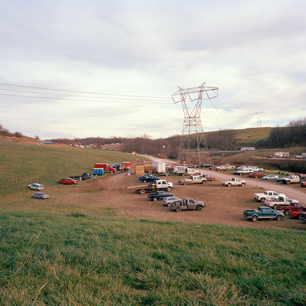 Power lines run over a parking field for workers building a gas pipeline near Claysville PA