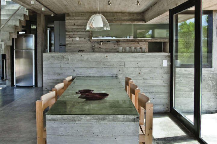 This kitchen is made of concrete and Canadian pine reclaimed from packing crates - Guillerme Morelli