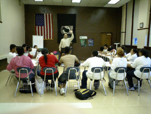 Todd as a Junior Achievement volunteer instructor at Senn High School