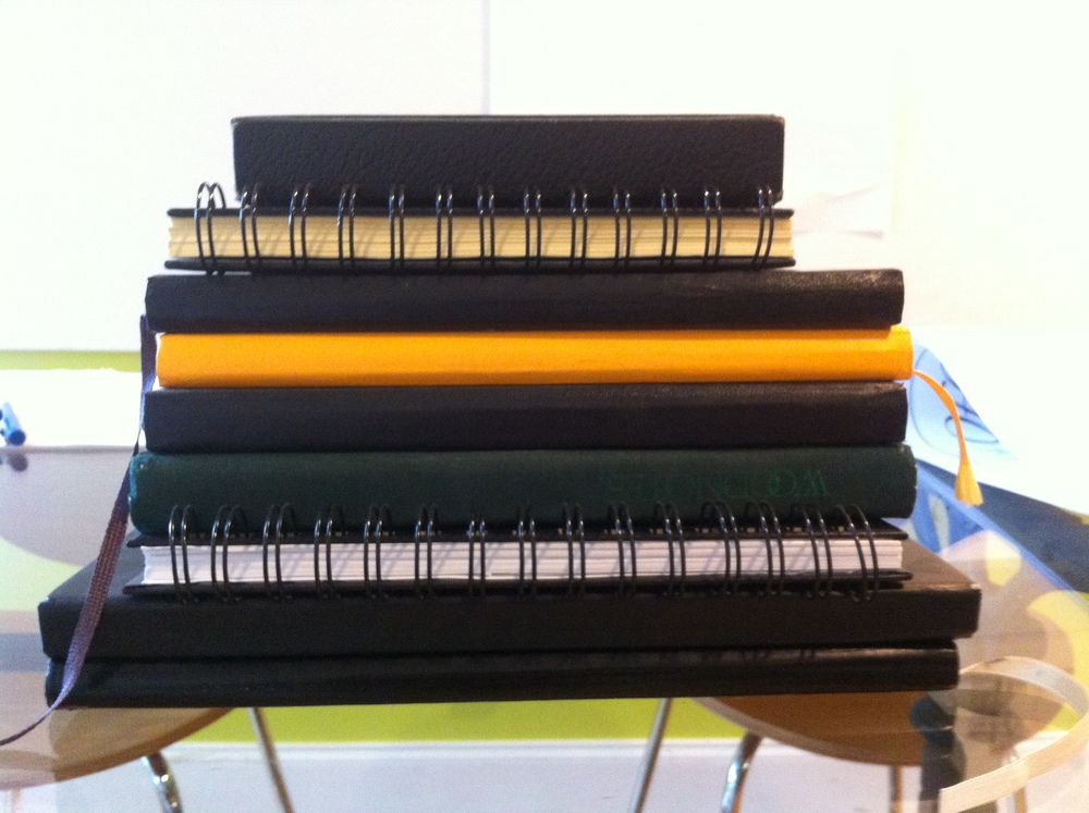 Stack of sketchbooks in the RDA studio