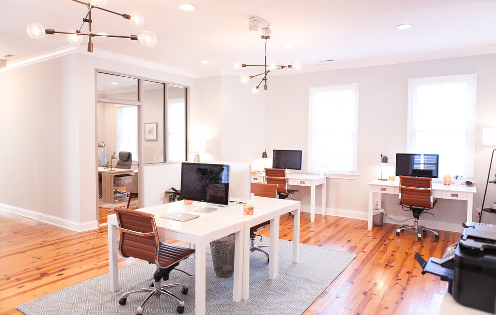 "Light-filled and dynamic, the open work space also known as the ""bull pen"" is a critical function to the daily office operations for Accountfully.  [Photo: Leslie Ryan]"