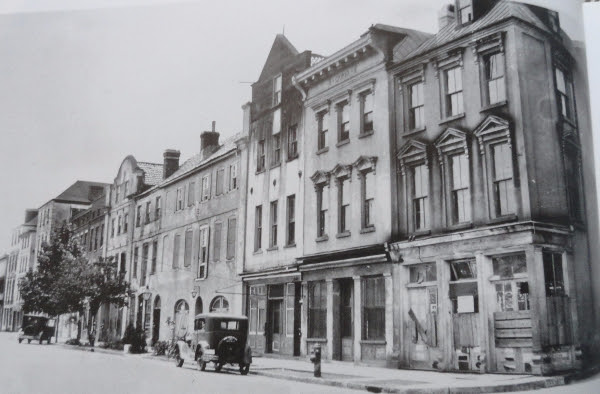 The buildings from 79 - 107 East Bay Street were originally designed as shops on the ground floor and residences above.
