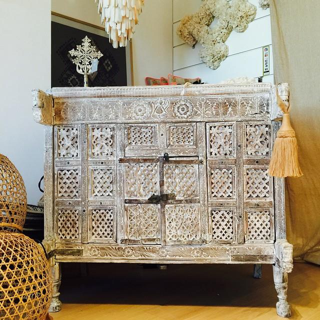 Whitewashed vintage dresser with detailed carving.jpg