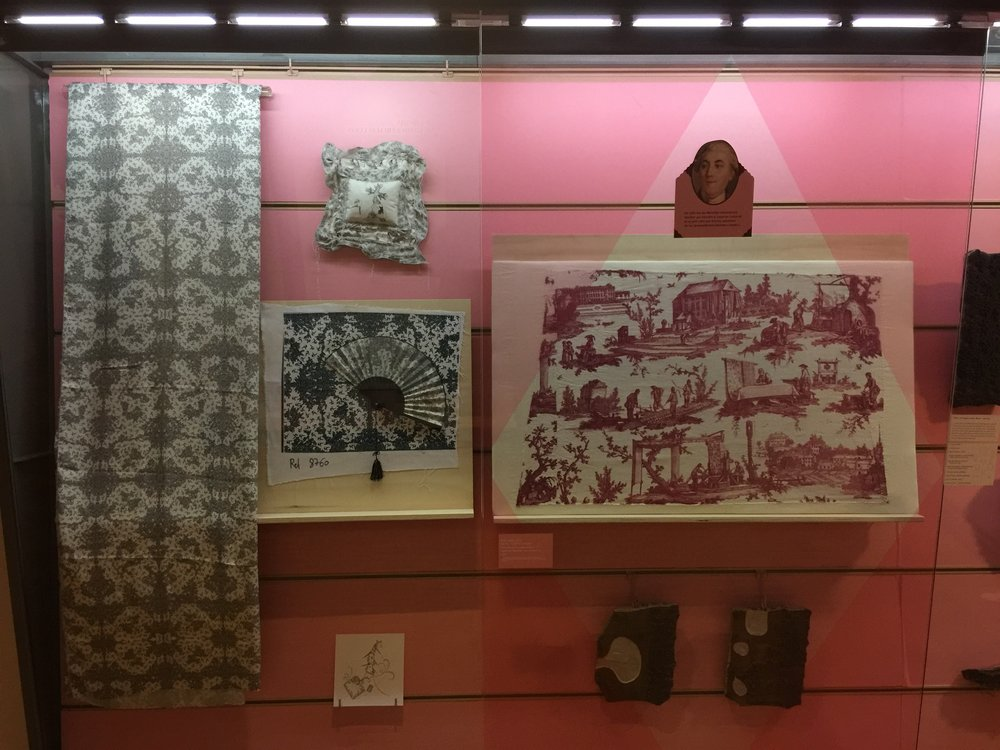 My work in glass cases next toToile Fabrics