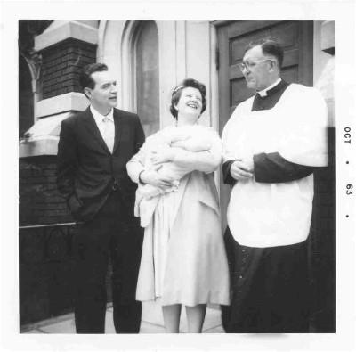 Fr. Higgins and Godparents talk after a baptism