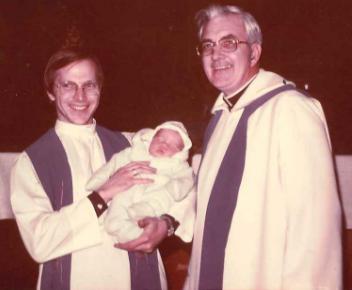 Fr. Mike Hazard, newly baptized little one, Fr. Bill Fitzgerald in 1976