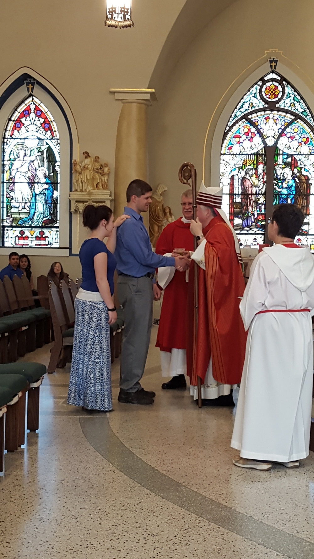Newly confirmed person receives Sign of Peace from Bishop Bradley 2015