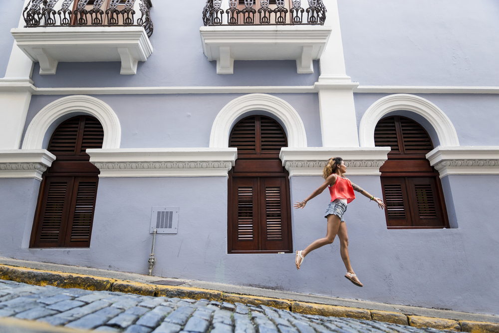 Amanda skipping through the narrow streets of Old San Juan.  Canon 6D, Tamron 24-70mm f/2.8 @24mm (iso1600, f/2.8, 1/160s)