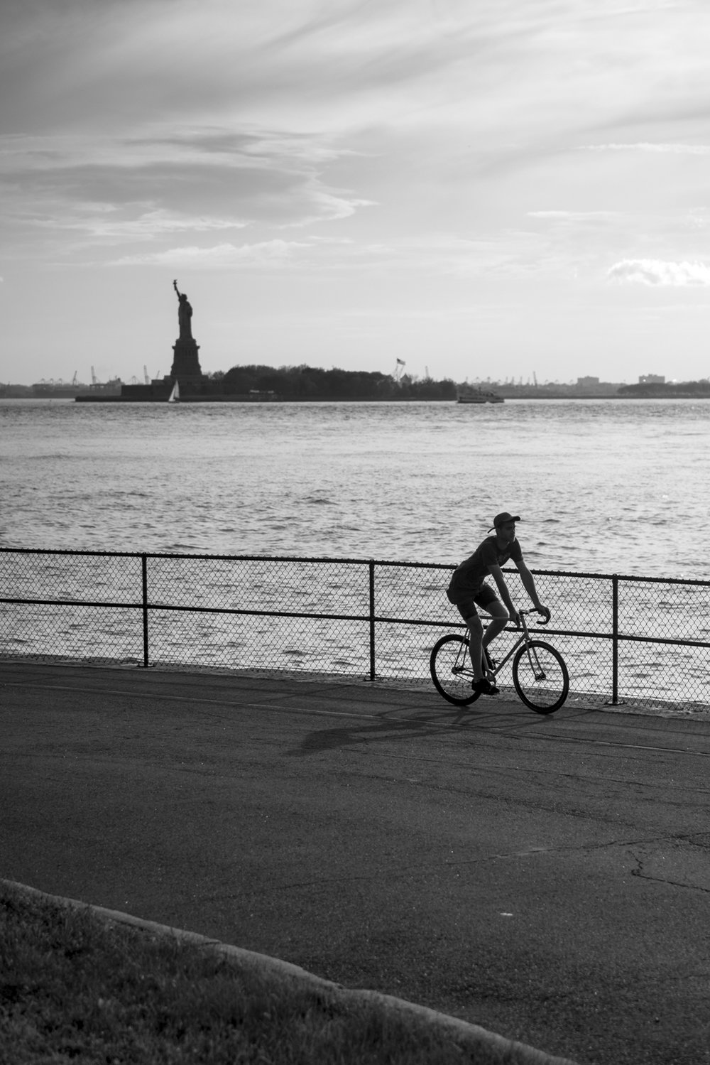 statue of liberty sunset bike silhouette austin paz