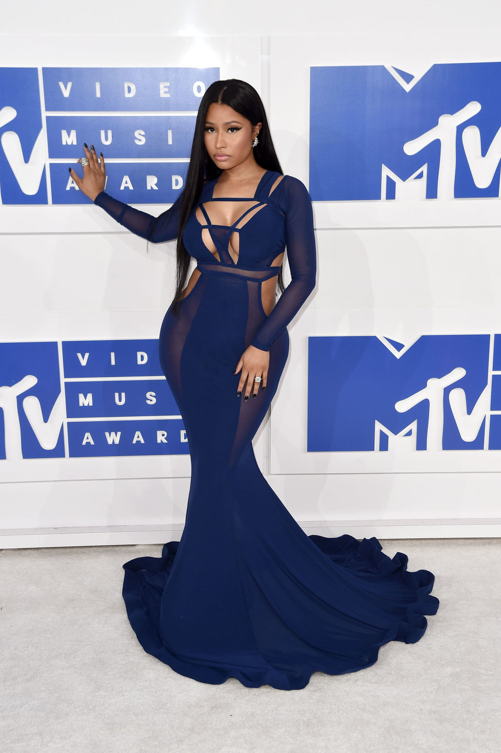 Working those lady lumps to the max, Nicki Minaj knows how to dress to impress with these strategic cut outs and mesh sides leaving just enough to the imagination.