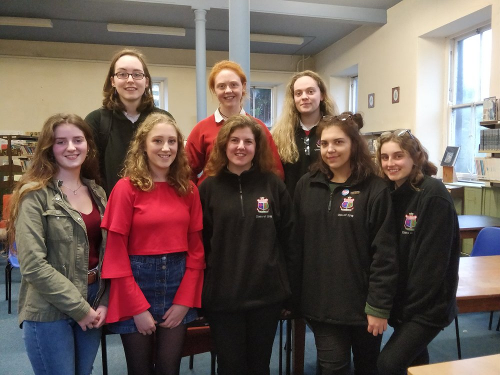 Roisin O'Sullivan and Orla Finnerty (front row on the left) with current 6th year students following their presentation.