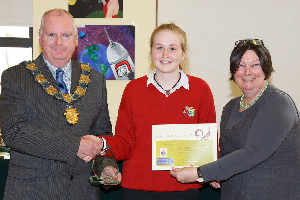Ellecia Vaughan presented with an award in recognition of six years full attendance at Sacred Heart