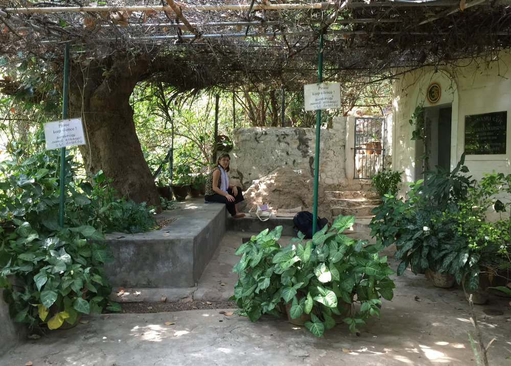 Outside the entrance to Sri Ramana Maharshi's cave on the sacred Arunachala mountain in Tamil Nadu, India