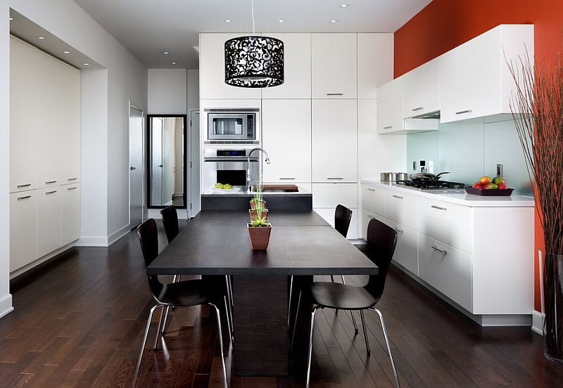 A-pop-of-orange-in-the-black-and-white-kitchen.jpg