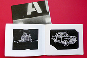 A Jon Waldo artist's book, filled with stencil drawings.