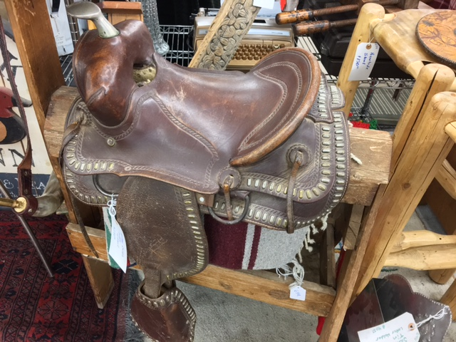 Vintage child's saddle with stand. $250.00