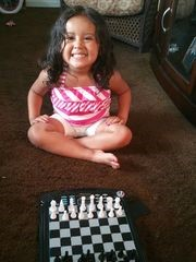 Ronald Olverson Jr. is teaching his granddaughter, Amaiya Villada, 3, how to play chess as part of his efforts to prepare her for college. (Photo: Provided)